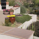 Retaining wall used to create space for new outdoor living area | 2004 ALCA Judges Award