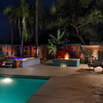 Colored concrete patio and pool deck with raised spa and fire feature | 2009 APLD Merit Award