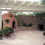 Allumawood shade ramada over flagstone patio with fireplace | 2002 ALCA Judges Award