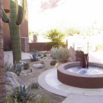 Custom fountain with tiled masonry basin and xeriscape plantings