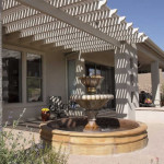 Mexican fountain on colored concrete patio with shade ramada | 2004 ALCA Judges Award