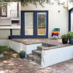 Brick patio and steps with potted plants | 2003 ALCA Judges Award