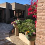 Bougainvillea and pots filled with winter annuals greet you as you enter the front courtyard.