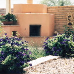 Fireplace with raised pot platform and wood storage | 2002 ALCA Judges Award