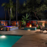 Raised gas fire pit at colored concrete patio and pool deck | 2009 APLD Merit Award