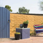 Wooden gate in painted slump block wall | 2003 ALCA Judges Award""