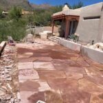 """After Filling the Old Pool with styrofoam bricks and 12"""" of Compacted AB Fill installed a new Flagstone Patio"""