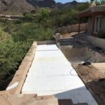 The lap pool filled with styrofoam and is ready for the layer of AB to be trucked in and then a new flagstone patio to be installed.