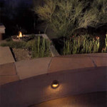 Wall light built in to seatwall with gas fire pit in background | 2004 ALCA Judges Award