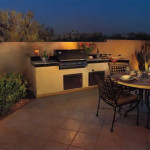 Lights accent outdoor kitchen and dining area | 2005 ALCA Judges Award