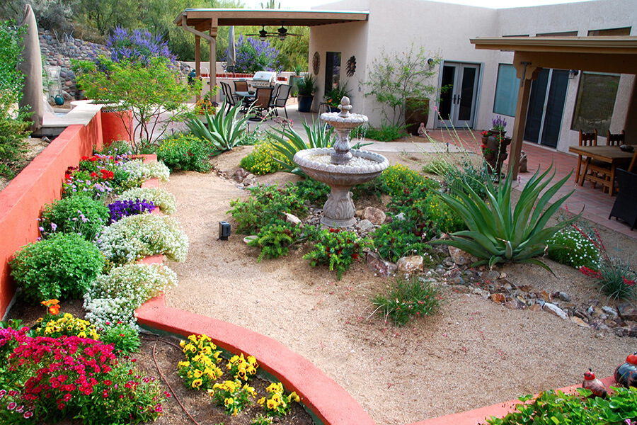 Landscape design and construction by sonoran gardens inc Backyard design pictures