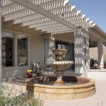 Allumawood shade ramada at colored exposed aggregate concrete patio | 2004 ALCA Judges Award