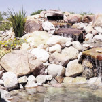 Rock waterfall and pond
