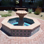 Fountain with hand carved canterra pedestal and hand painted custom tiles.