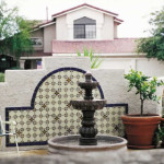 Mexican fountain with tile background